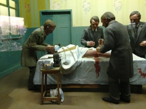 By Dody's time surgeons were wearing gowns and sometimes even gloves when performing operations. To the right of the patient's head you can see 'Lister's Steam Spray' in use, making a mist of carbolic to disinfect the air around the patient. Dody uses a similar device during an operation at the end of Antidote to Murder.
